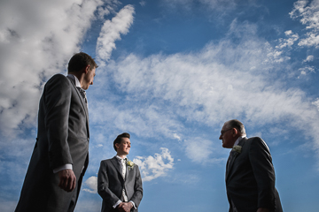 Groomsmen blue skies UK wedding photographer