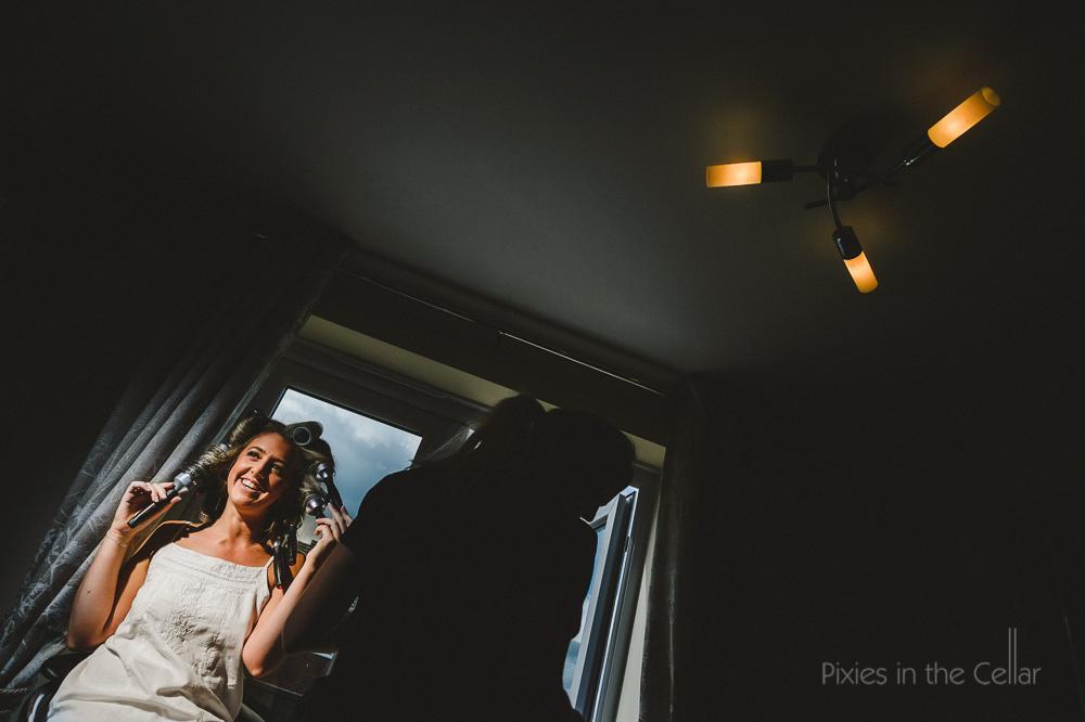 bride in hairbrush rollers