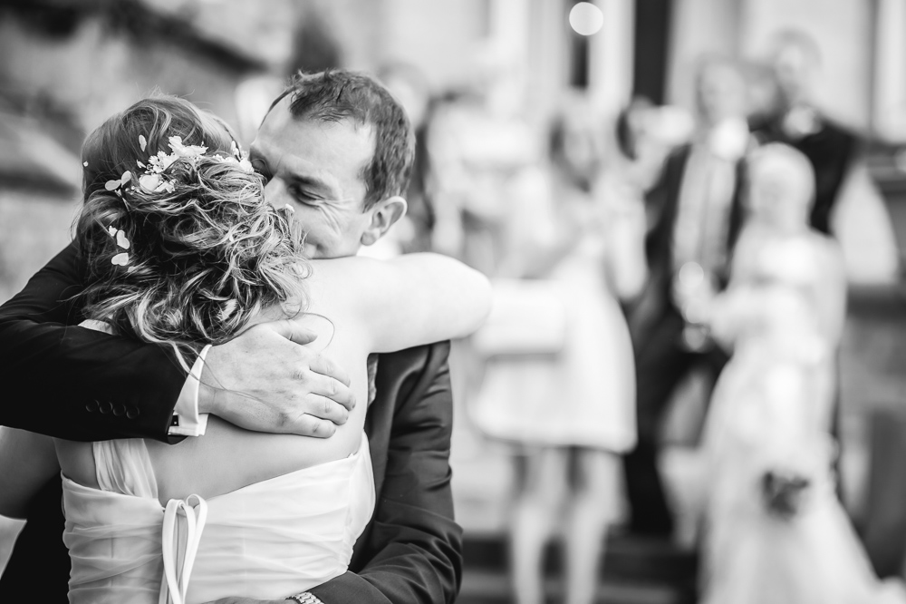 bride dad hugs at wedding