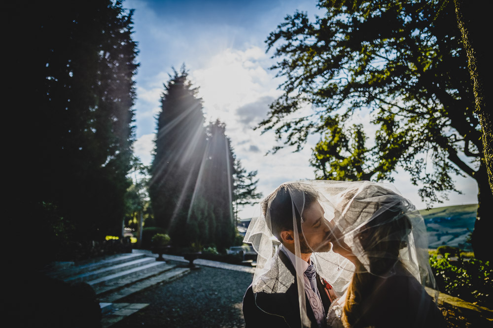 bride groom kissing veil