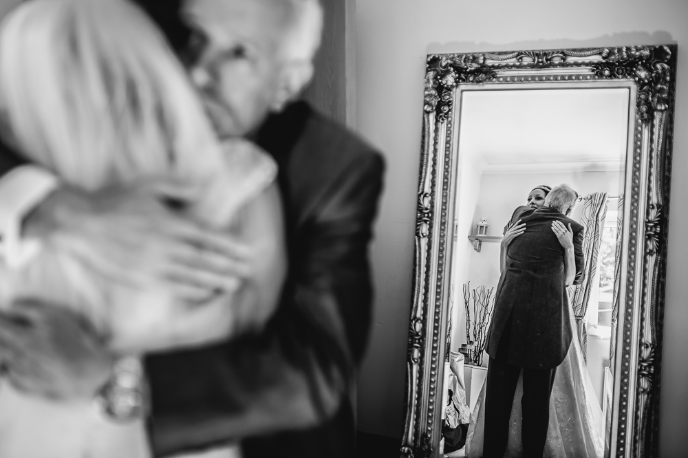 bride and dad in mirror
