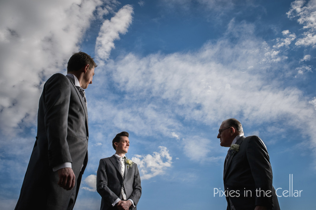 Groomsmen blue sky cheshire wedding photographers
