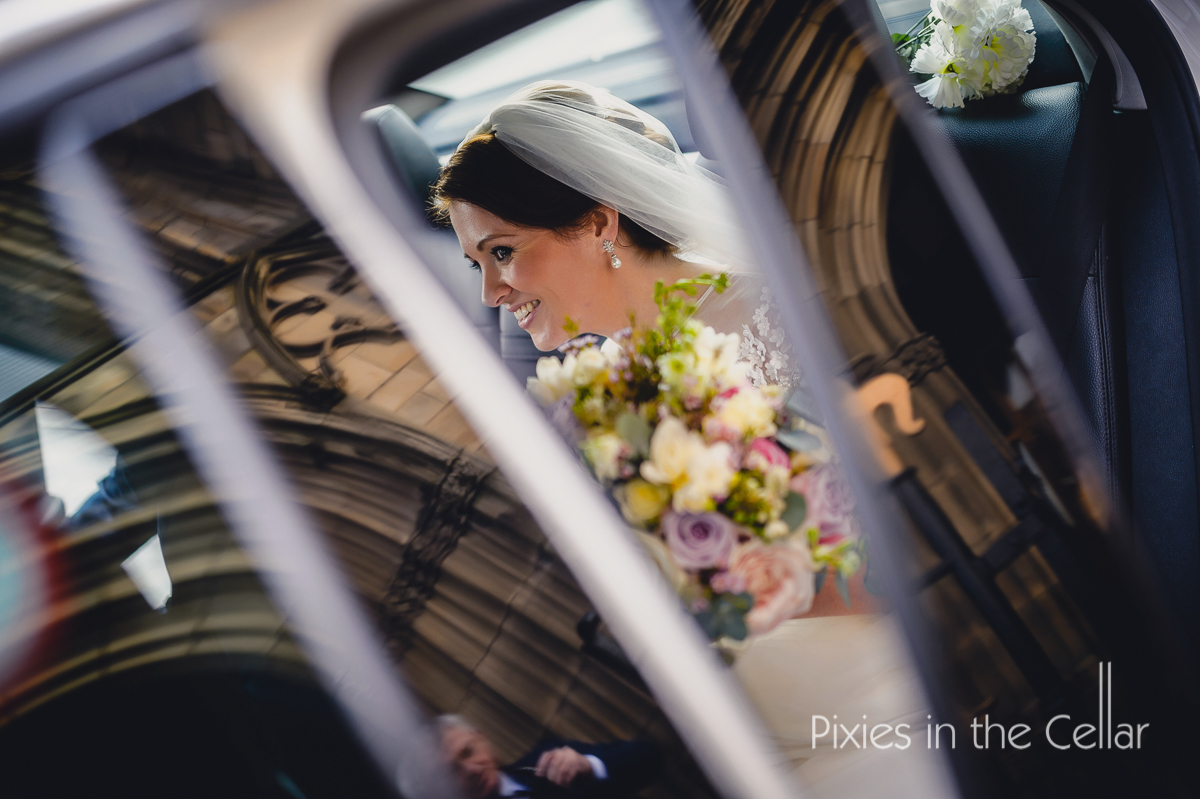 bride in car salford cathedral wedding reflection photo