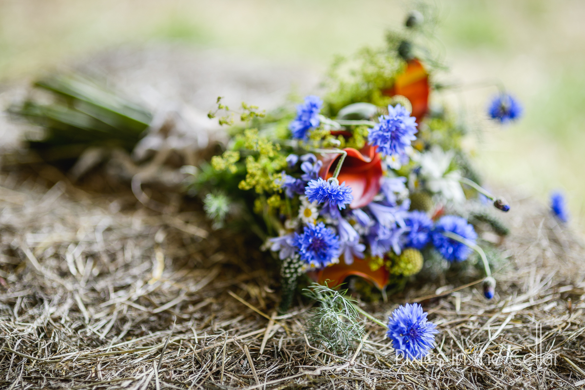 hay bale and wedding bouquet