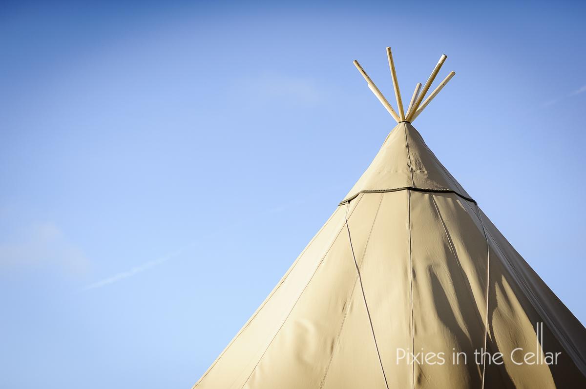 tipi blue sky rustic outdoor wedding