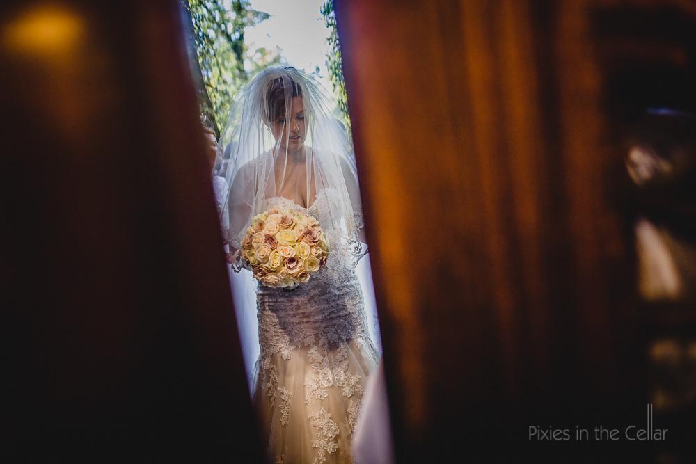 bride waiting through door