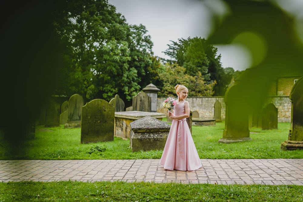 pink flower girl on church path yorkshire