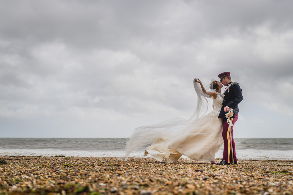beach wedding seaside military veil wind