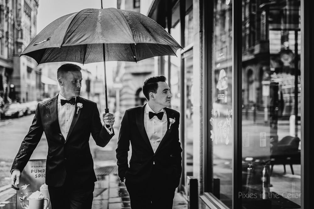 Manchester city centre wedding photography rain black tie