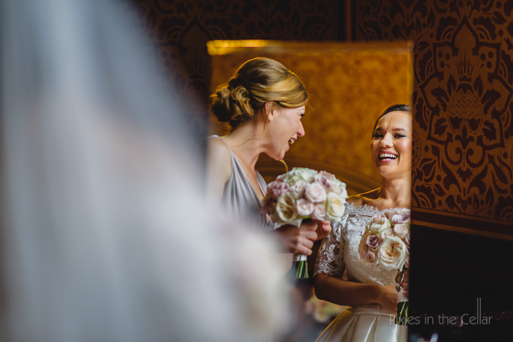 bride bridesmaid laughing