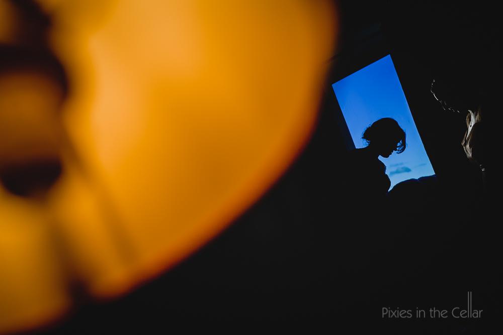 window silhouette wedding preparations