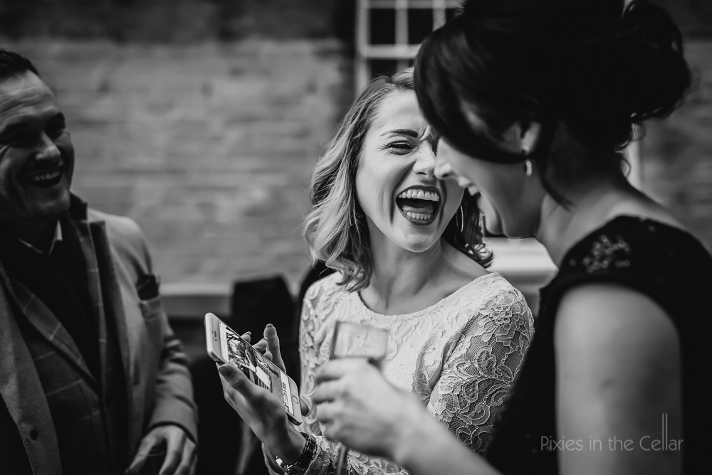 wedding guests laughing documentary photography