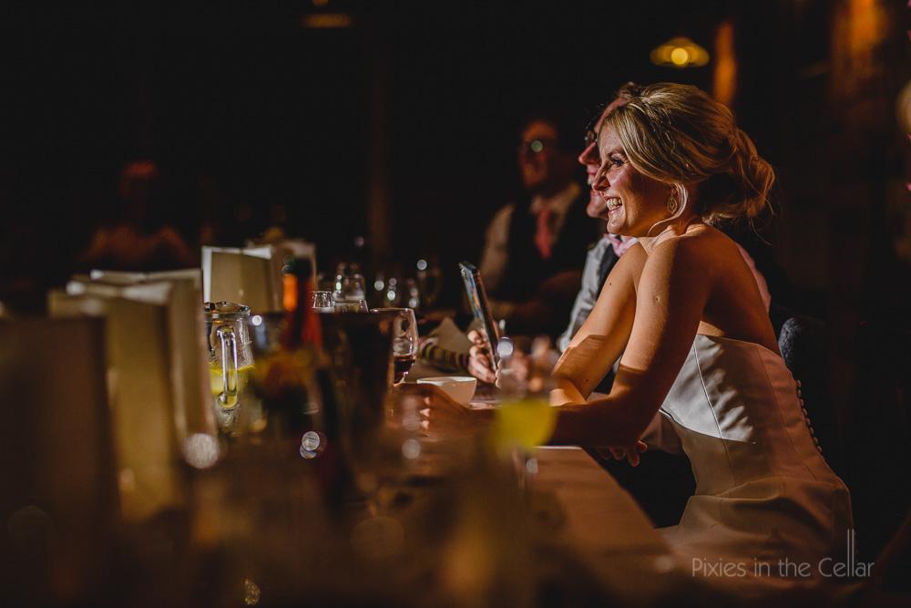 bride smiling at wedding breakfast