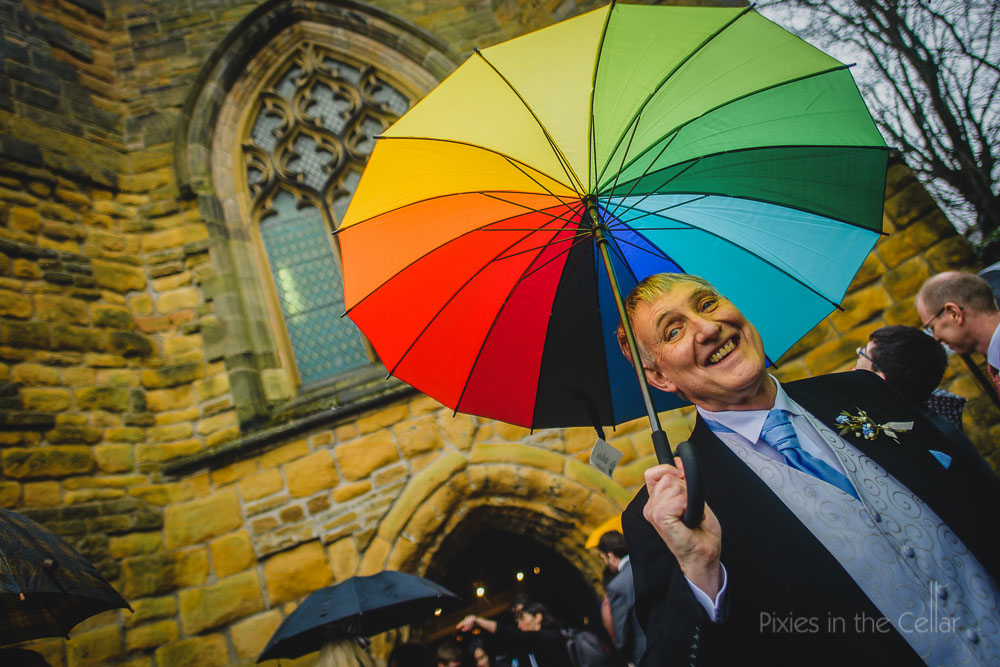 embrace the rain on your wedding day colourful umbrella