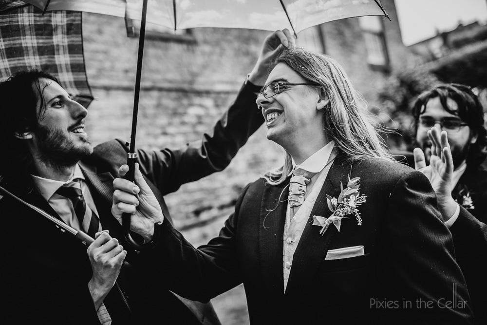 groom and confetti