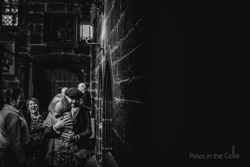 chethams wedding photography hugs with guests