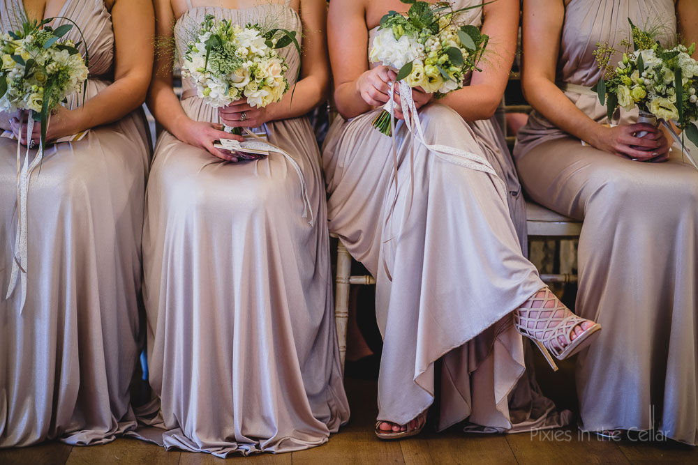 Neutral bridesmaids and flowers