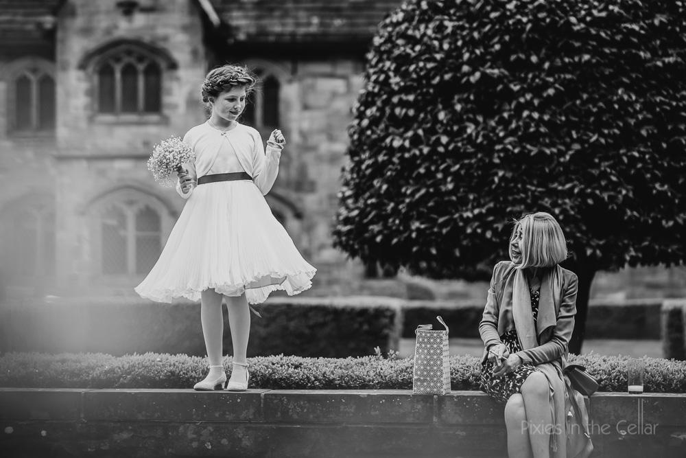 young bridesmaid on wall