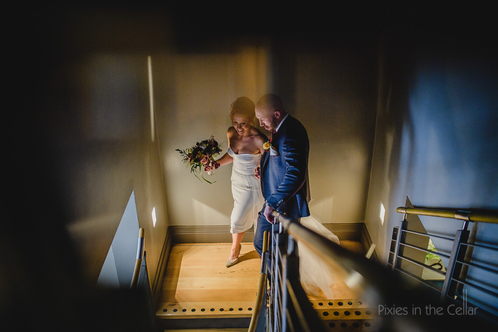 bride and groom on stairs natural documentary photography