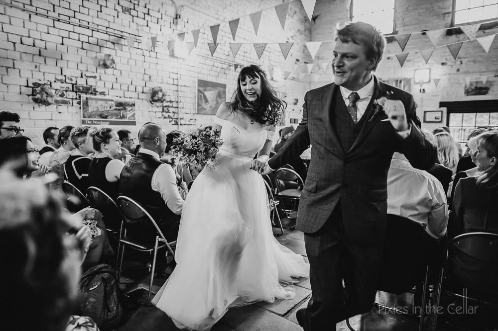 Just married joy dancing bride groom