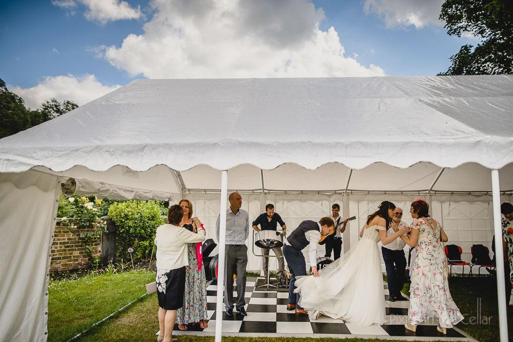 steel strum wedding party bride on dance floor