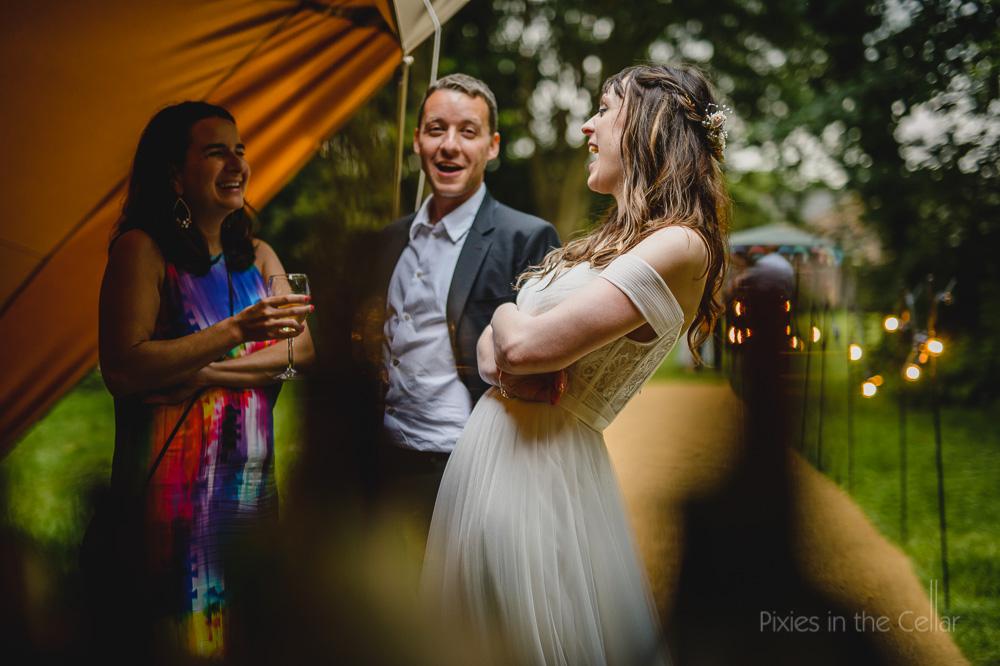 friends weddings laughter tipi evening light