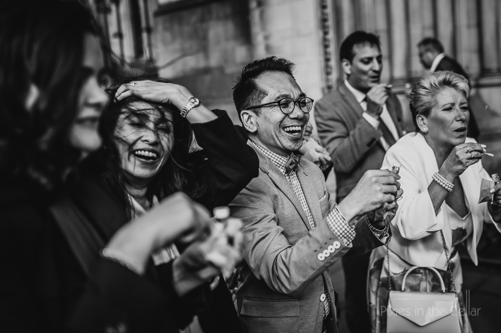 wedding guest smiles city centre wedding
