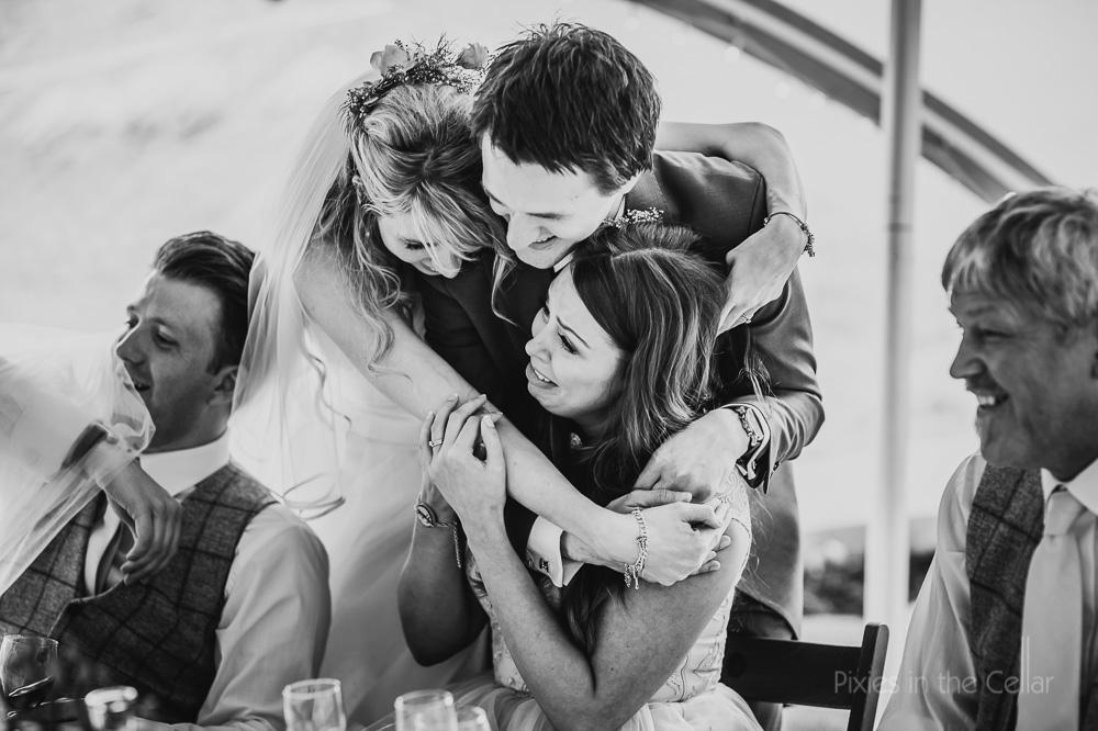 family hug at wedding natural wedding photography