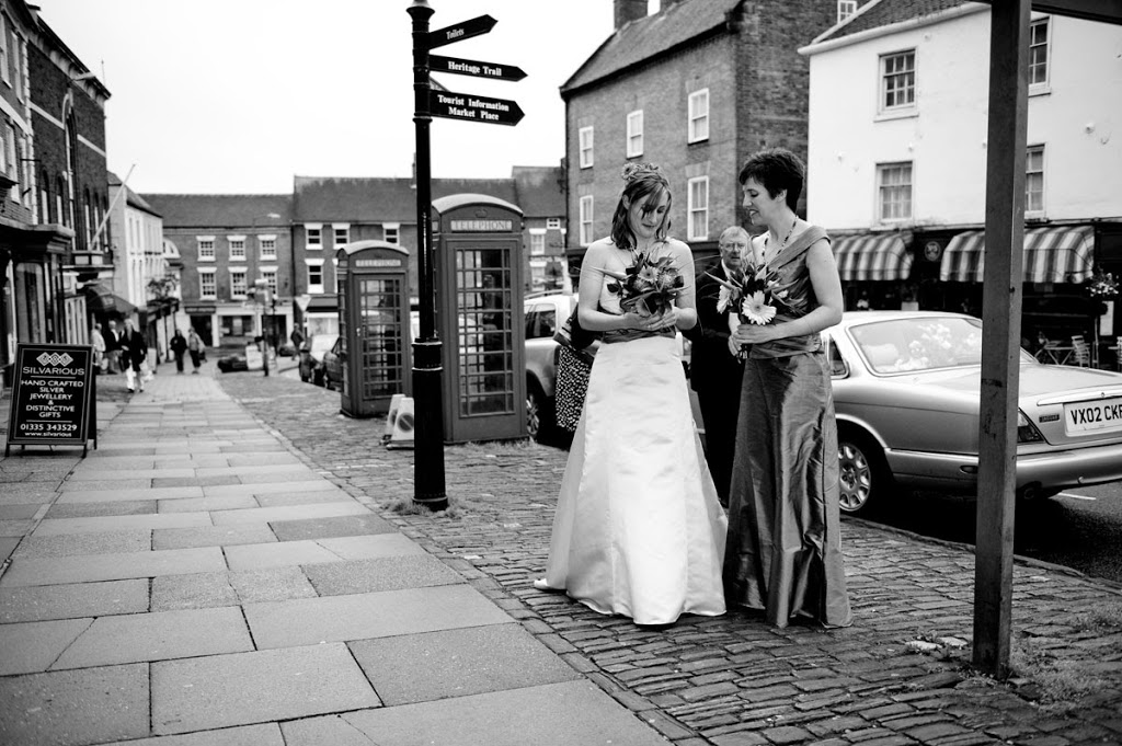 Gay wedding in Ashbourne two brides outside town hall