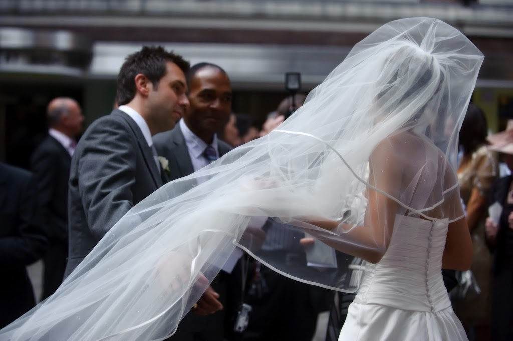 Bride and long veil in wind