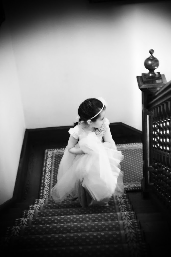 flower girl on stairs