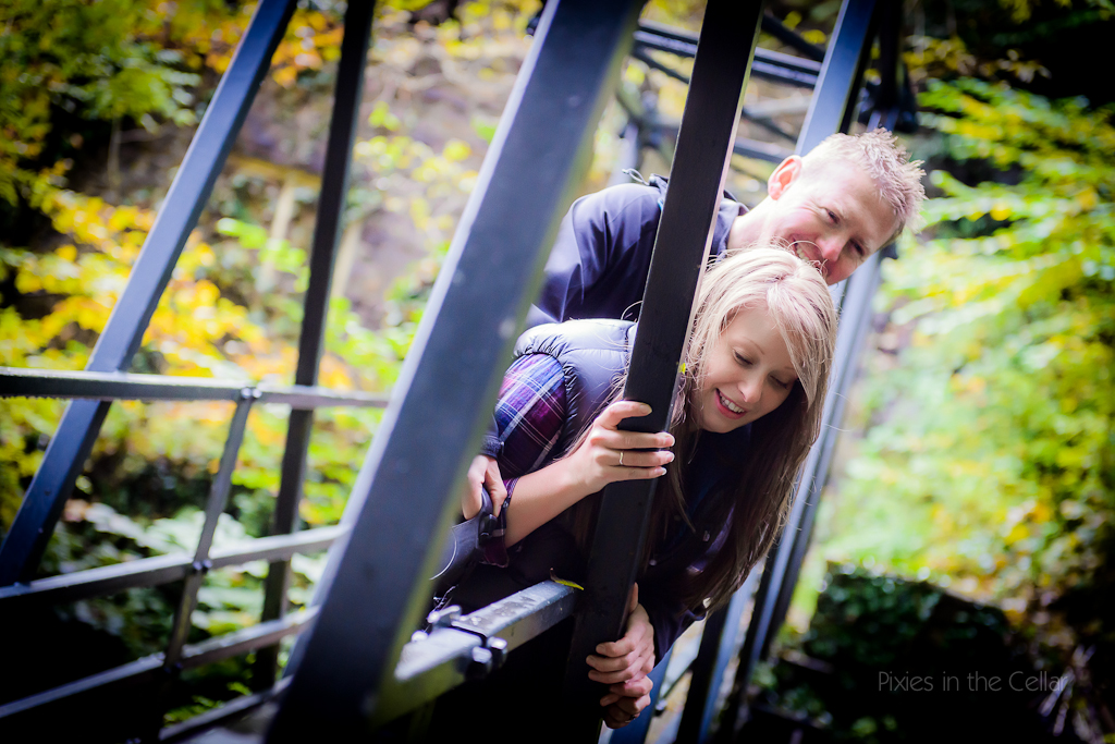 Couple looking over iron bridge