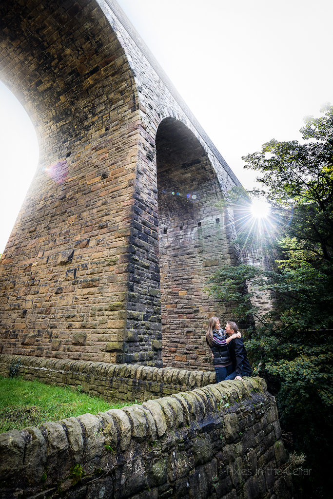 viaduct and engaged couple