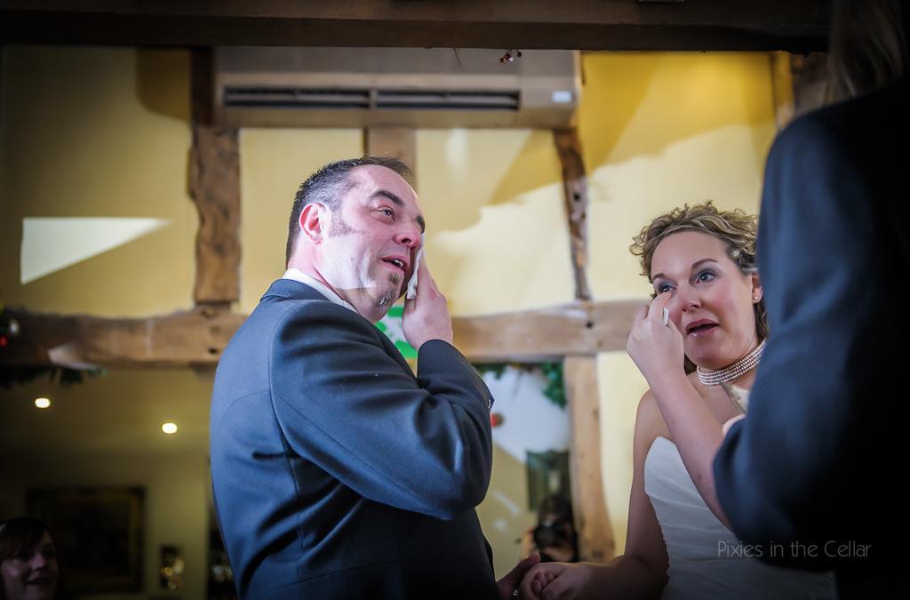 bride and groom wedding tears