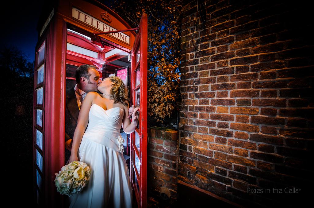 british telephone box with wedding couple