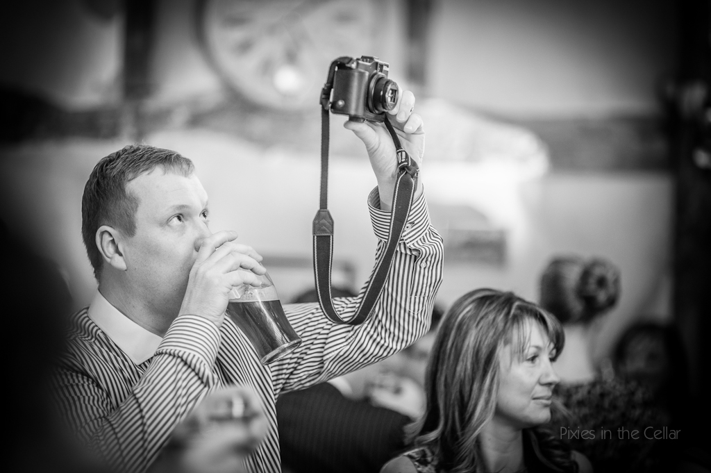 wedding guest camera and beer