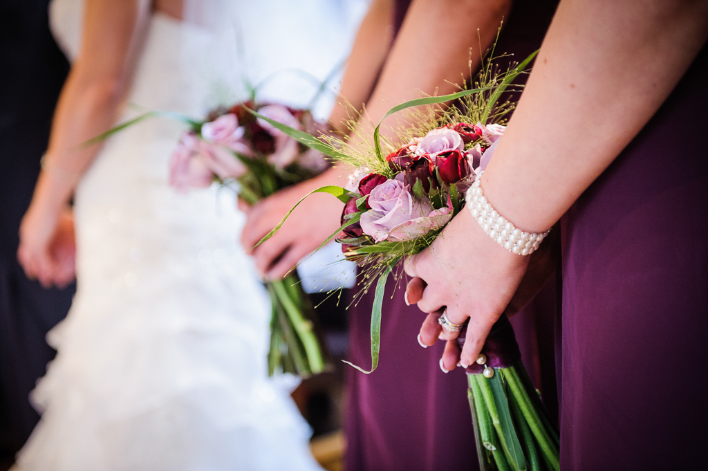 purple bridesmaids flowers and pearl bracelets
