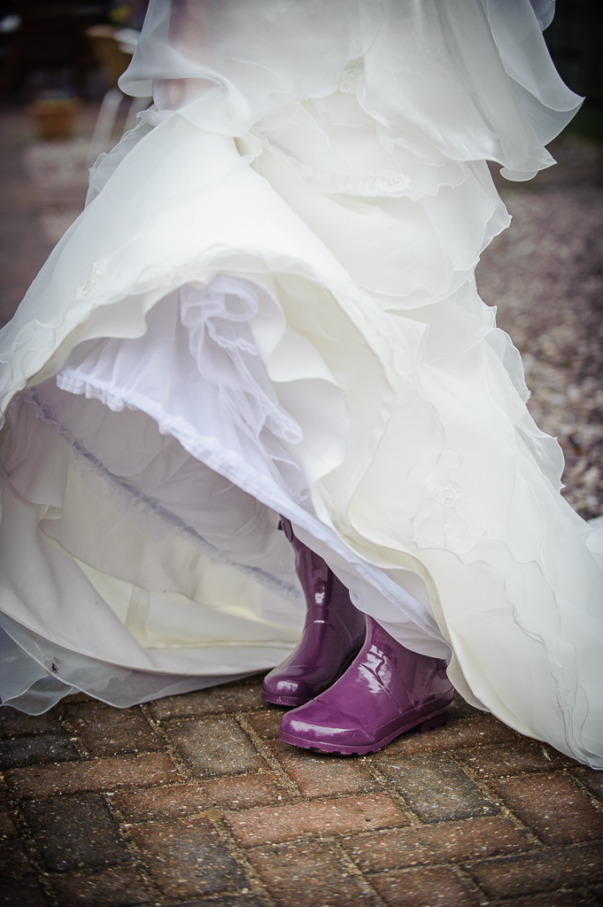 purple wellies and wedding dress