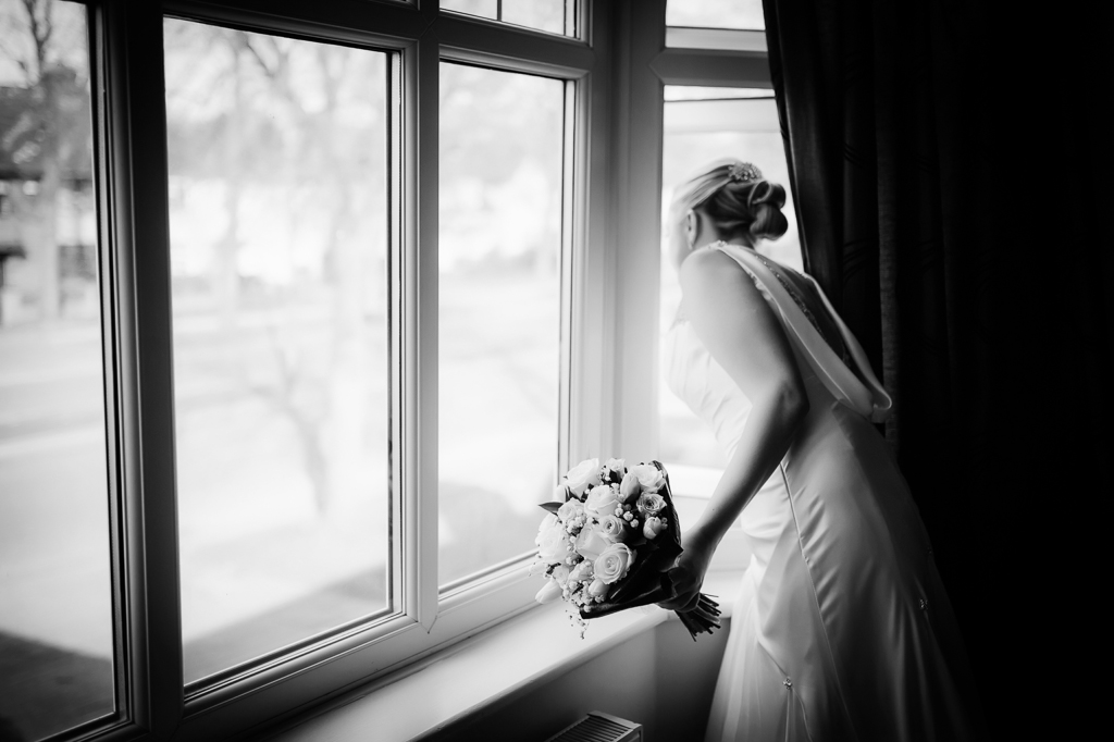 bride looking out of window liverpool wedding