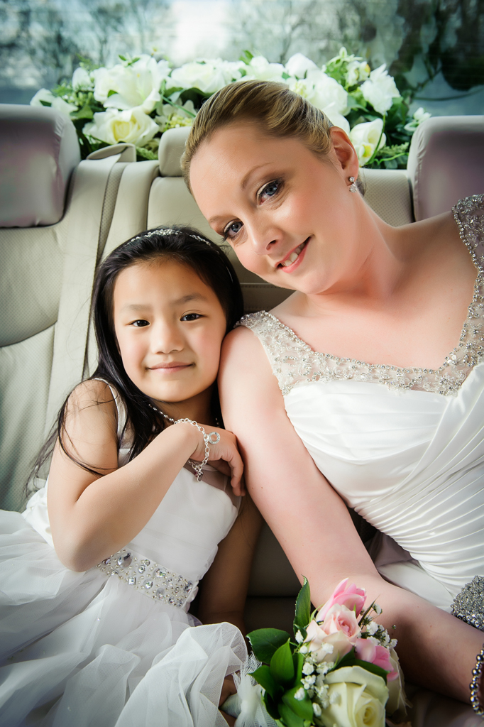 bride and flower girl in car