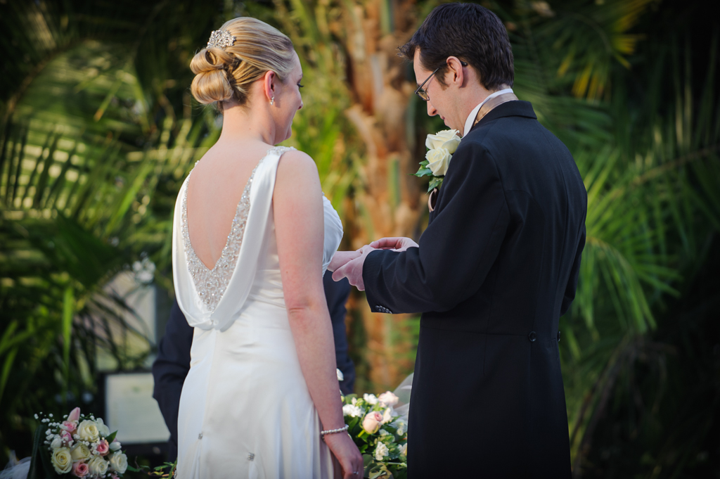palm house wedding exchanging rings