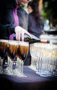Guiness in champagne glasses at wedding