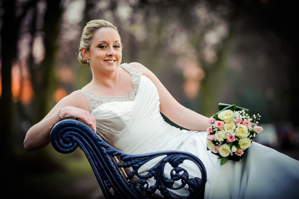 bride on bench at sunset