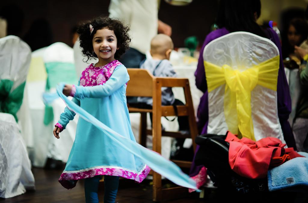 girl twirling at wedding