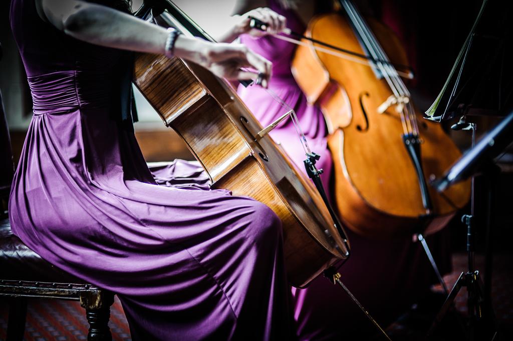 String quartet in purple dresses