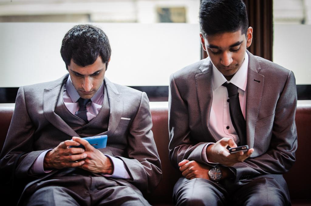 wedding guests on phones