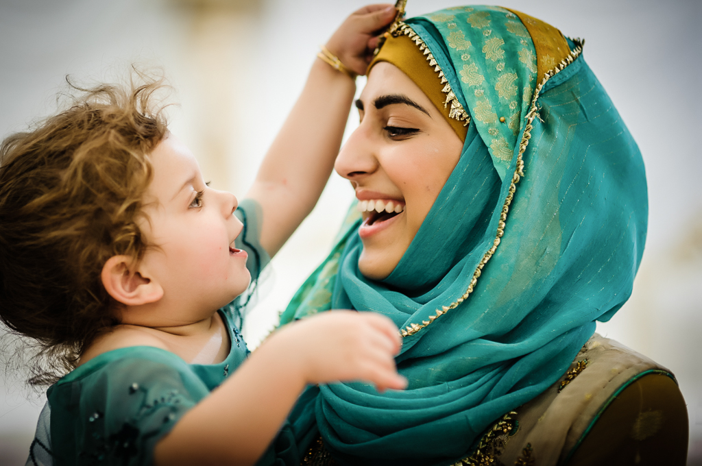 mum and daughter laughing turquoise headscarf
