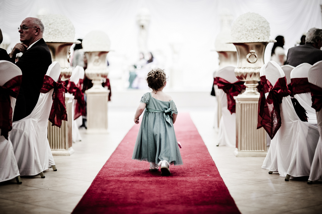 little girl on red carpet at asian wedding Manchester