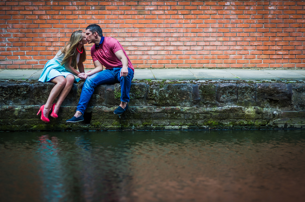couple kissing on the side of canal