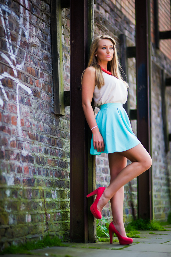girl short blue skirt and red shoes